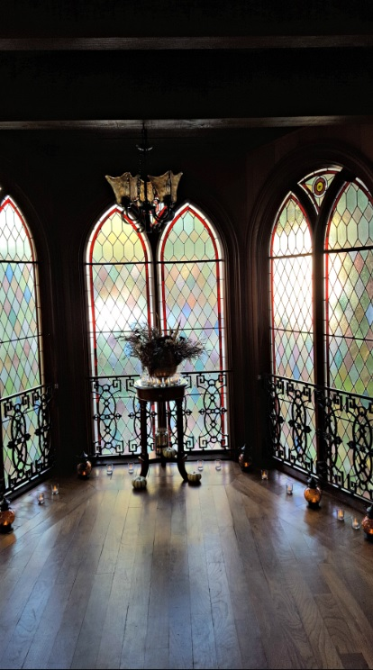 Stained glass alcove for Halloween wedding in Nevada City, California